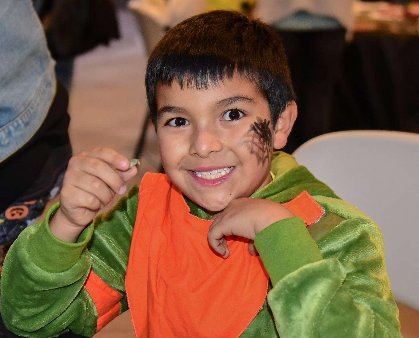 Boy dissecting owl pellets, Halloween Happening Highlands Center