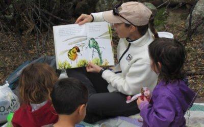 Jessie reading a book to Knee High Naturalists